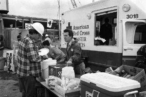 A Red Cross worker provides meals to residents and responders in Oakland following the 1989 Loma Prieta Earthquake