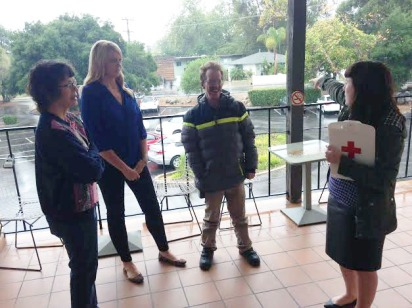 Melissa Durand, Business Operations Coordinator, pointing out our pre-designated gathering spot to volunteers Gayle Robinson and Timmy Kriedman, as well as Major Gifts Officer Kimberley Coley