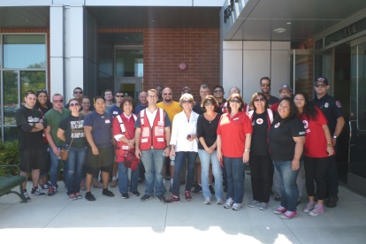 Red Cross volunteers who canvassed neighborhoods to install smoke alarms as part of the Home Fire Campaign