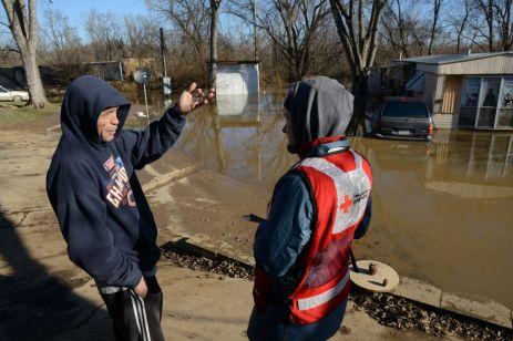 January 1, 2016 -- Missouri Floods Dale Vaughn asses his flooded neighborhood near Arnold, Missouri. Photo by Daniel Cima/American Red Cross