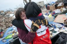 January 2, 2016 -- Garland, Texas -- ERV crews take donated meals from an area Chilis Restaurant to areas of Garland and Rowlett affected by the recent tornadoes. ERV team member Roxanne Bunkoff hugs Cathrine Armstrong, who was sorting through the rubble of her home in Rowlett. Photos by Dennis Drenner for the American Red Cross.