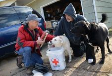 Missouri Floods. Red Cross volunteer John Lewis helps Bill Baugher with a clean-up kit during the flood relief effort in Arnold, Missouri. Photo by Daniel Cima for the American Red Cross