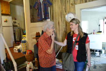 A Red Crosser comforts Daurline Tanner after floodwaters damaged her home