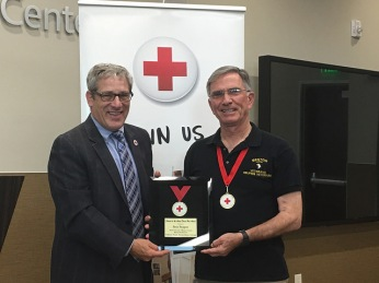 Pete Pepper accepts her Heroes honor from PG&E Rep and Red Cross Board Chair Mike Meko