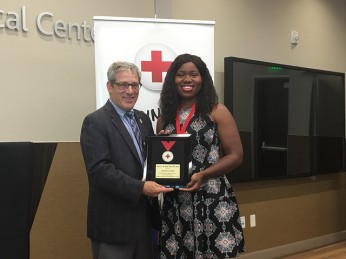 Sandra Gould accepts her Heroes honor from PG&E Rep and Red Cross Board Chair Mike Meko
