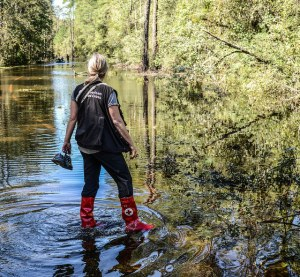 Volunteer Virginia Becker, surveying a residential street that turned into a river after Hurricane Matthew.