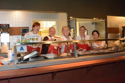 Red Cross volunteers providing meals to residents at the Spartenburg Expo Shelter. Photo by Virginia Becker
