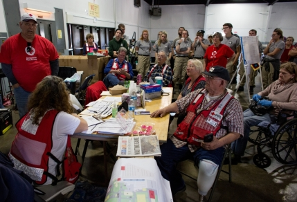 Red Cross workers congregate for an afternoon meeting at the Silver Dollar Fairgrounds shelter in Chico, CA. Photo: Marko Kokic, American Red Cross