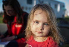 Two-year-old Samantha started running a fever at the shelter, and disaster health workers helped prescribe medicine and even picked up the prescription for the family at the local pharmacy. Photo: Marko Kokic, American Red Cross