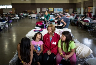 Red Cross volunteer Emily chats with shelter residents Natalie, Anna, and Eliza at the Red Cross shelter in Chico. Marko Kokic, American Red Cross