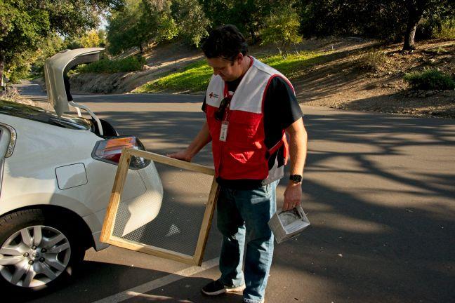 Red Cross volunteer deliver sifters during supplies distribution in Westlake Village.