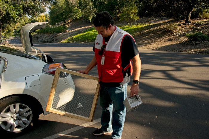 Red Cross volunteer deliver sifters during supplies distribution in Westlake Village.
