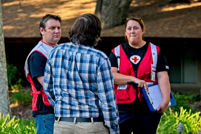 Red Cross volunteers discuss available resources with Westlake Village resident.